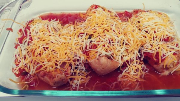 Remove the chicken and salsa from the crock pot, cover with cheese, and bake until the cheese is melted.