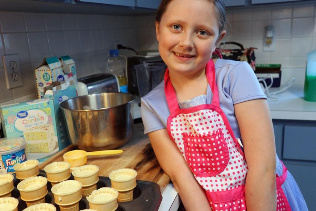 birthday girl makes cupcakes