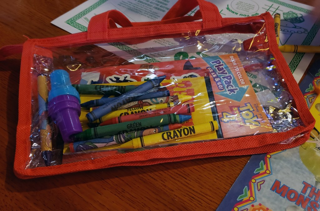 kids' busy bag with crayons and activities for a restaurant