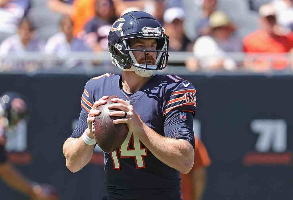 Andy Dalton #14 of the NFL Chicago Bears looks for a receiver against the Miami Dolphins during a preseason game at Soldier Field on August 14, 2021 in Chicago, Illinois. The Bears defeated the Dolphins 20-13.
