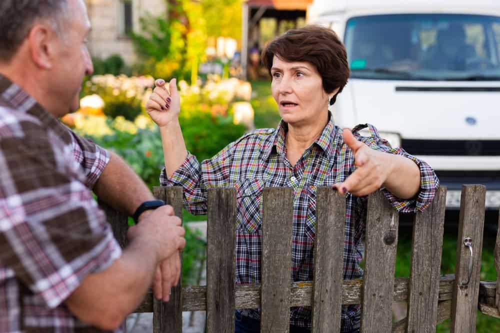 Neighbors man and woman chatting