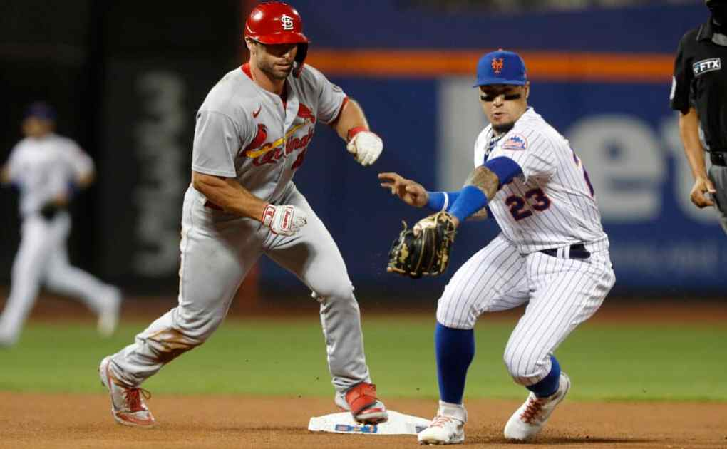 Paul Goldschmidt #46 of the St. Louis Cardinals beats the throw to Javier Baez #23 of the New York Mets at second base for a double during the fourth inning at Citi Field on September 14, 2021 in New York City.