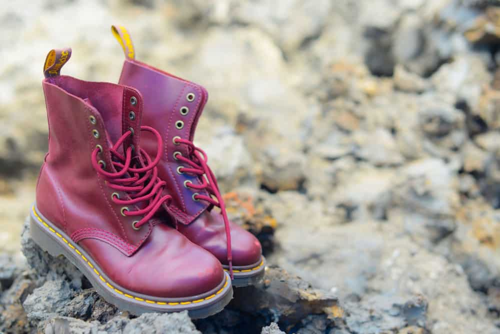A pair of Dr Martens 8 eyelet 8 inch classic unisex cherry red oxblood lace-up fashion combat boots