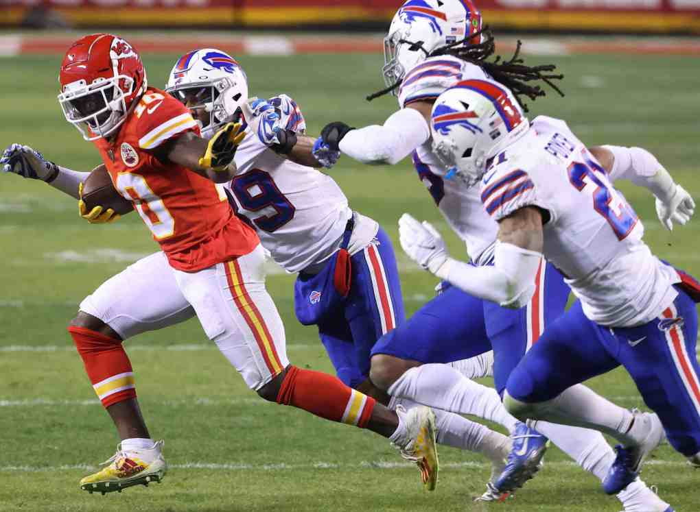Tyreek Hill #10 of the Kansas City Chiefs runs with the ball in the second half against the Buffalo Bills during the AFC Championship game at Arrowhead Stadium on January 24, 2021 in Kansas City, Missouri.