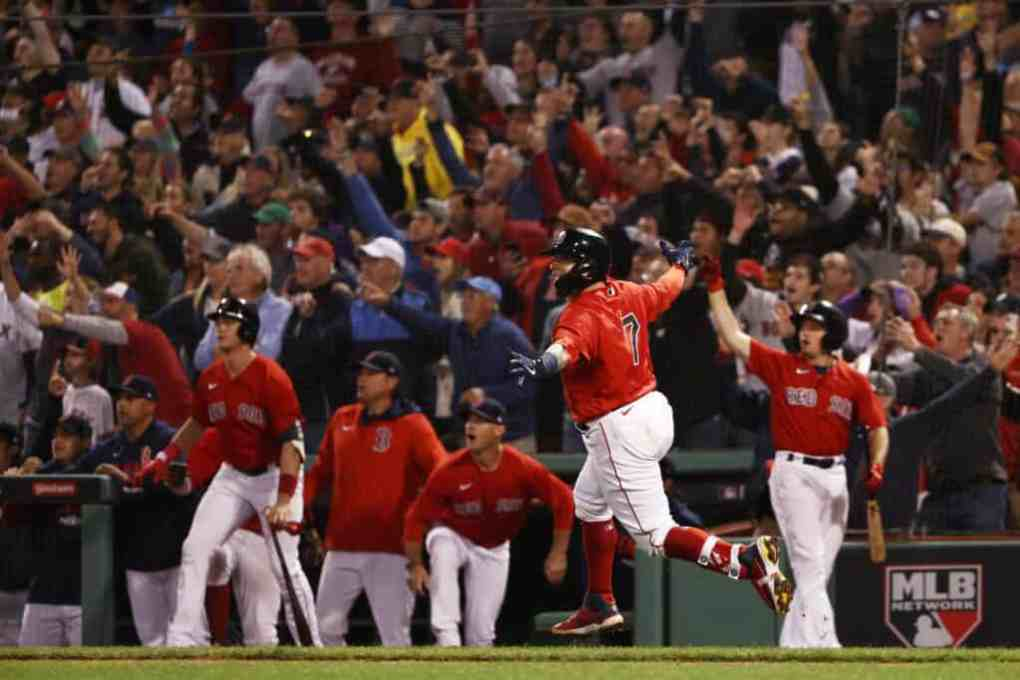 Christian Vazquez #7 of the Boston Red Sox celebrates his game winning two-run homerun in the 13th inning against the Tampa Bay Rays during Game 3 of the American League Division Series at Fenway Park on October 10, 2021 in Boston, Massachusetts.