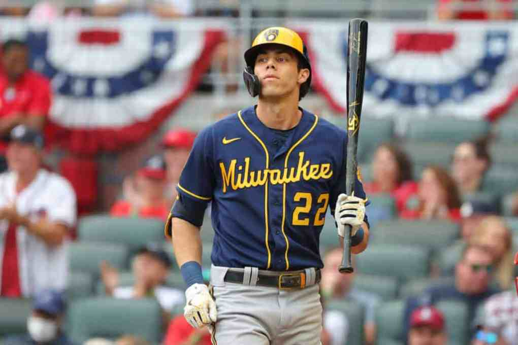 Christian Yelich #22 of the Milwaukee Brewers bats during the second inning against the Atlanta Braves in game four of the National League Division Series at Truist Park on October 12, 2021 in Atlanta, Georgia.