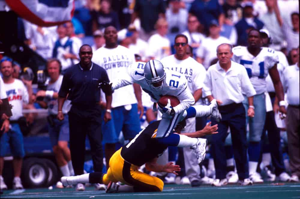 Cornerback Deion Sanders of the Dallas Cowboys is tackled during the Cowboys 37-7 victory over the Pittsburgh Steelers at Three Rivers Stadium in Pittsburgh, PA.