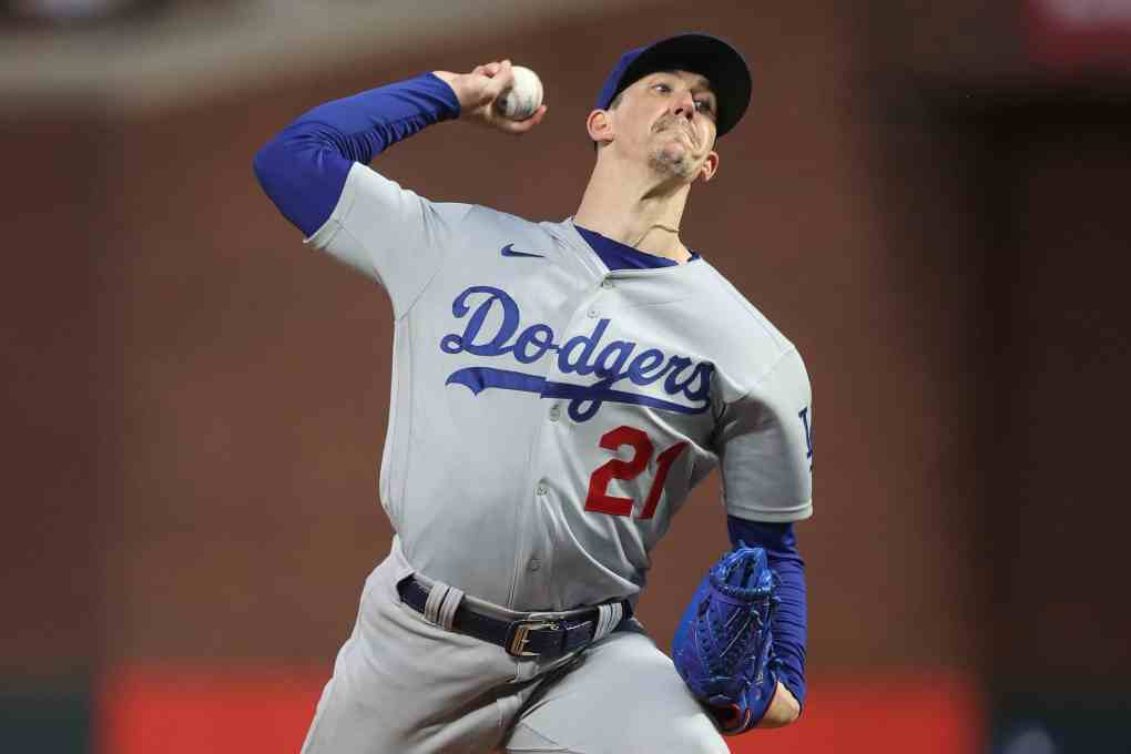 Walker Buehler #21 of the Los Angeles Dodgers delivers a pitch against the San Francisco Giants during the first inning of Game 1 of the National League Division Series at Oracle Park on October 08, 2021 in San Francisco, California.