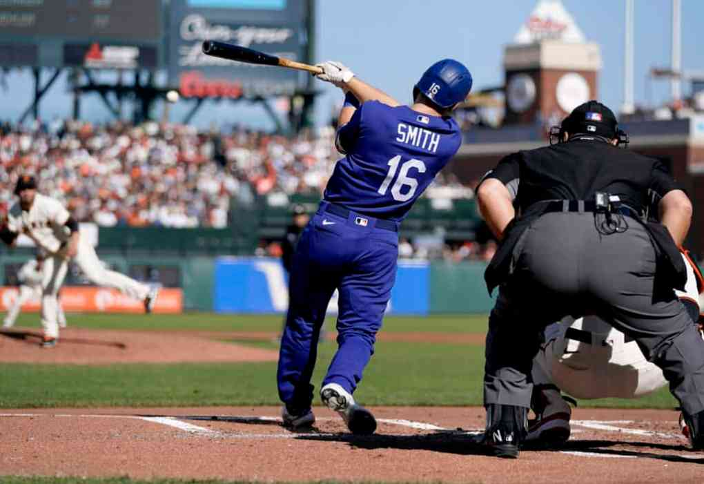 Will Smith #16 of the Los Angeles Dodgers hits an RBI single scoring Justin Turner #10 against the San Francisco Giants in the top of the second at Oracle Park on September 05, 2021 in San Francisco, California.