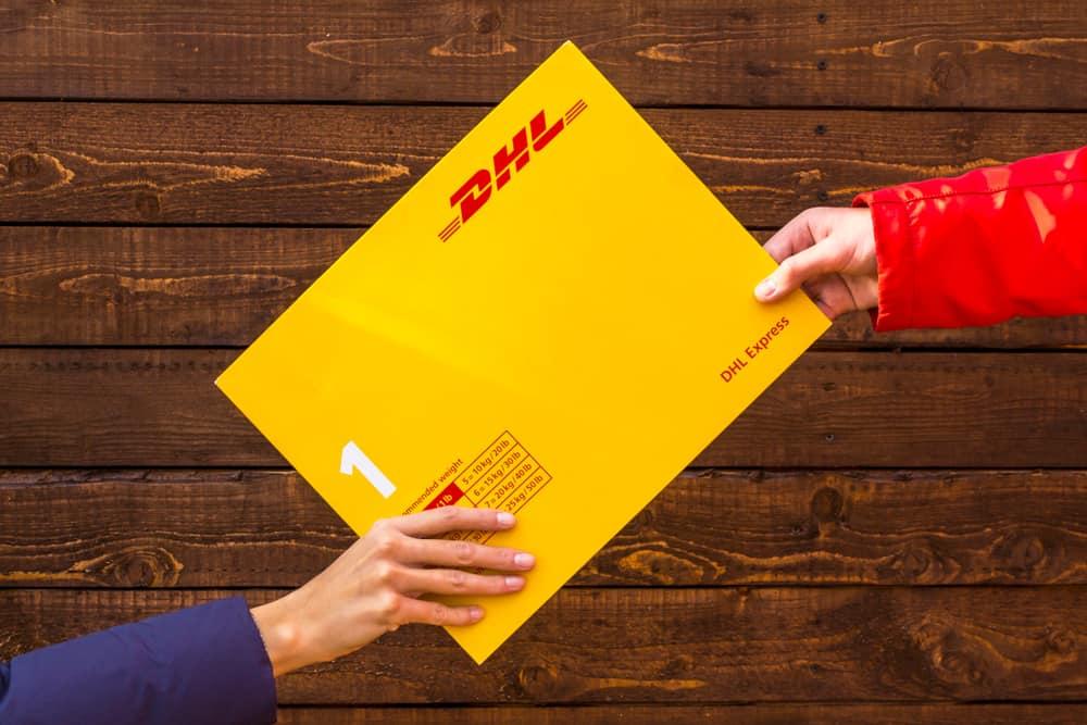 Hand holding Envelope logo DHL