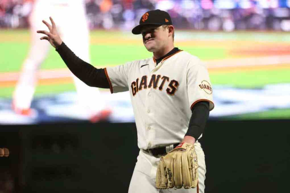 Logan Webb #62 of the San Francisco Giants acknowledges the crowd as he is taken out of the game against the Los Angeles Dodgers during the eighth inning of Game 1 of the National League Division Series at Oracle Park on October 08, 2021 in San Francisco, California.