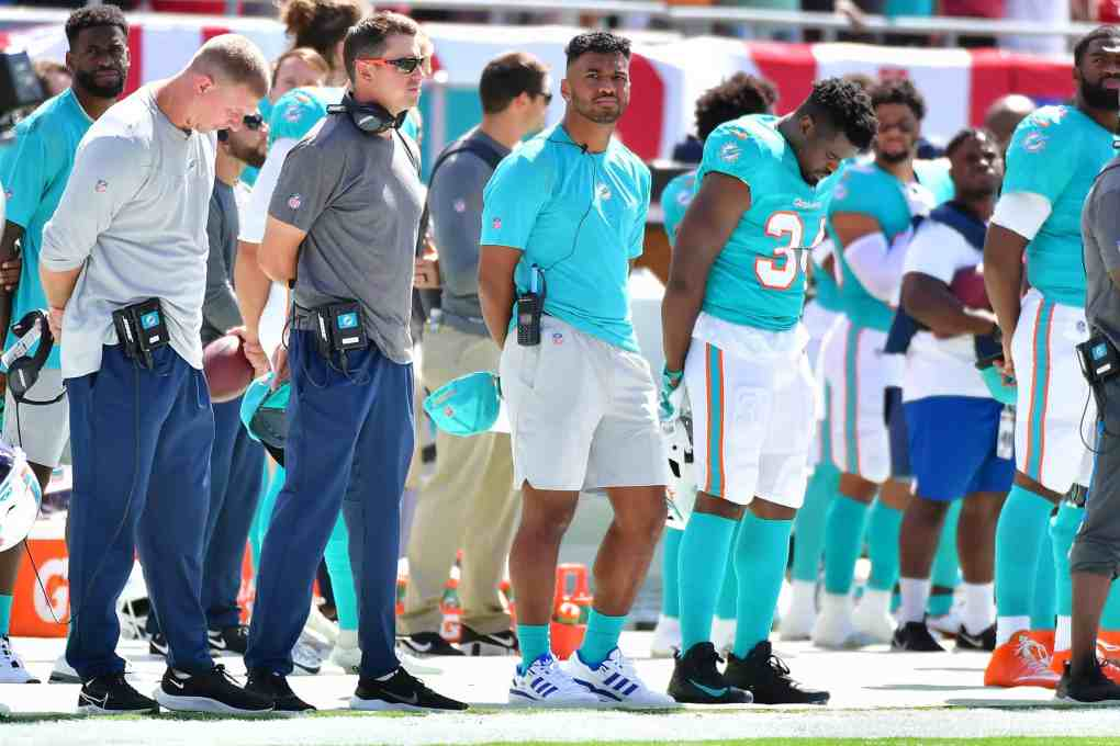Tua Tagovailoa #1 of the Miami Dolphins observes the playing of the national anthem prior to the game against the Tampa Bay Buccaneers at Raymond James Stadium on October 10, 2021 in Tampa, Florida.
