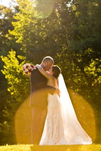 Couple kissing in the sunlight