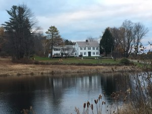 Colonial house and pond