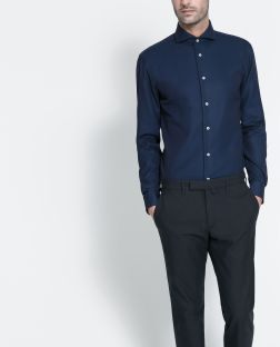 Navy blue shirts go well with black pants