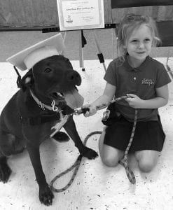 Anna Maria Pluss and her rescue dog Sweet Pea cer tainly earned thei r Praise Dog Training graduation certificate. Anna Maria wasn't much taller than Sweet Pea, but they excelled at all the exercises.