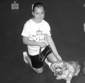 Rebecca Bryan is now in college at USC. She star ted dog t raining wi th her dog Chloe in a basic obedience class and eventually competed in Rally Obedience. Little Rebecca competed against adults and won her first Rally Obedience class.