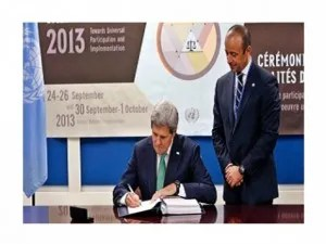 Secretary of State, John Kerry, signing away America's freedom, security and longevity.