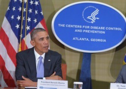 """""""See the CDC sign in the background, it is designed to make you trust me. The CDC knows exactly what they are doing to the American people""""."""