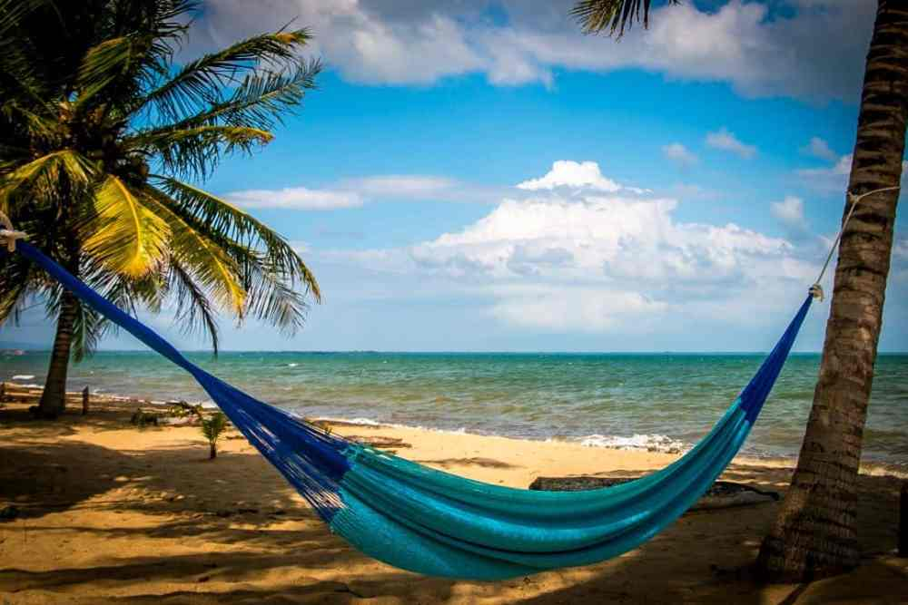 Top 10 Best Things To Do in Belize featured by top US travel blog, The Common Traveler: image of Hammock on beach at Hopkins Village in Belize