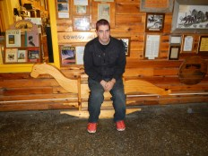 Kenin on a bench in Wall Drug | Wall SD