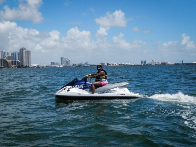 Lauren riding a jet Ski as part of her Tropical Sailing Miami tour