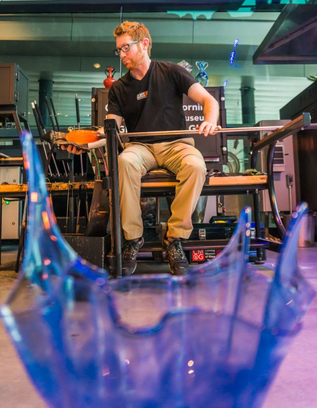 Gaffer at work blowing Glass