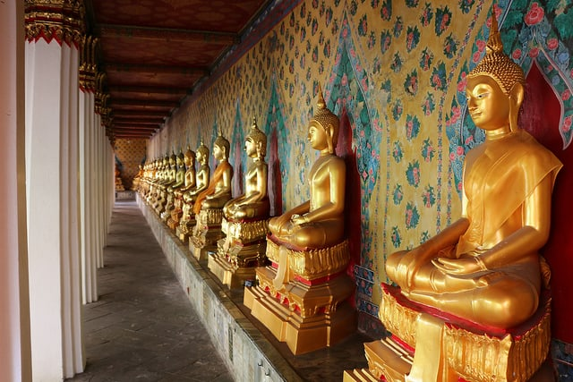 row of golden Buddha statuettes