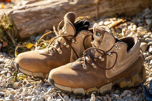 hiking boots on rocks
