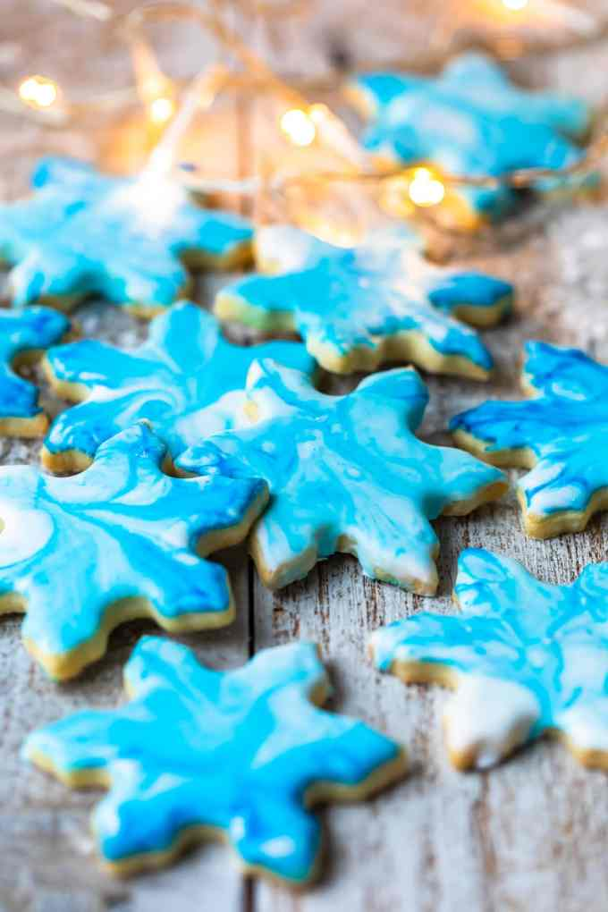 Snowflake butter cookies with blue confectioners sugar frosting