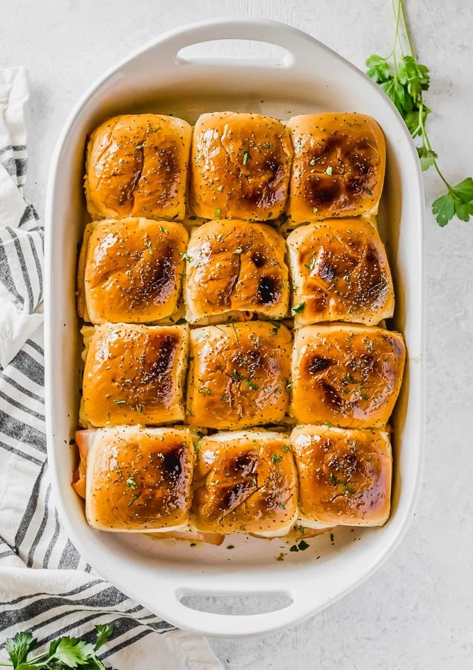 ham and cheese sandwiches in a baking dish