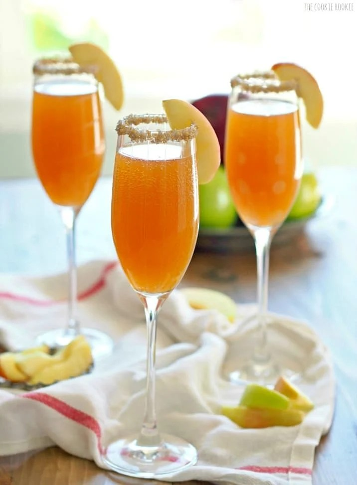 three glasses filled with apple mimosas