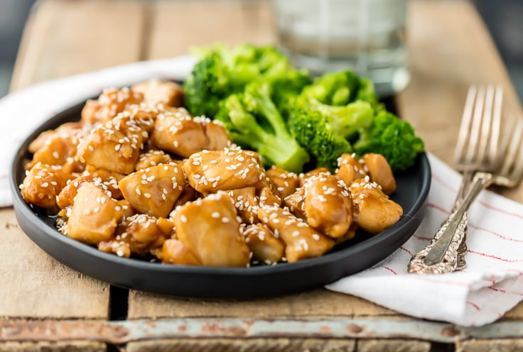 easy teriyaki chicken recipe on a plate with broccoli, set with two forks