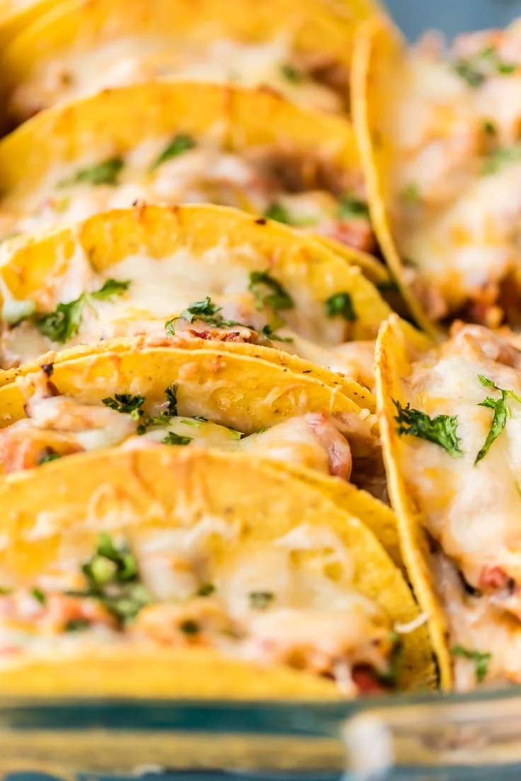 baked chicken tacos from side in a pan