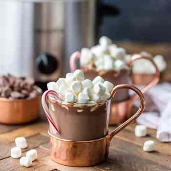 Slow Cooker Peppermint Hot Chocolate is the perfect recipe for peppermint lovers! We LOVE this Slow Cooker Hot Chocolate recipe because it's so easy to make. It's made with sweetened condensed milk so this crockpot hot chocolate is SUPER CREAMY!