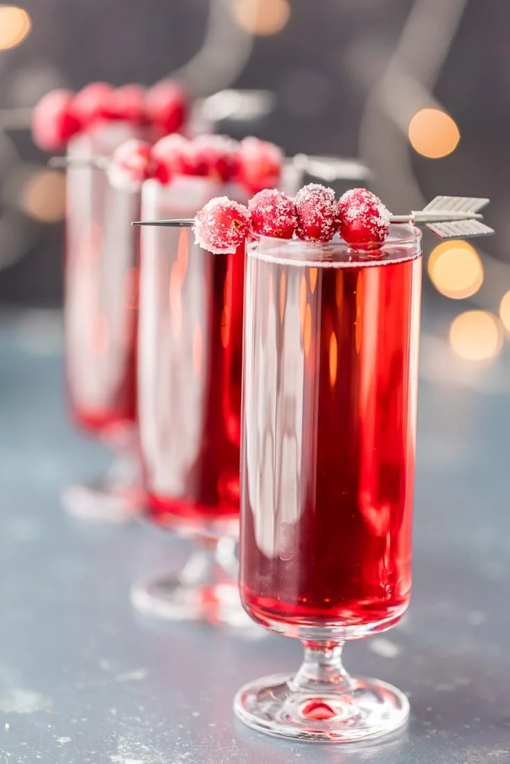 cranberry ginger mimosas with sugared cranberries garnish