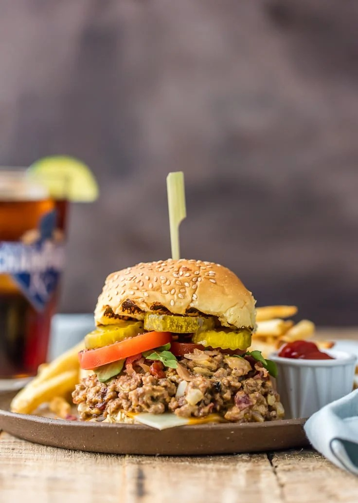 a large serving of slow cooker bacon cheeseburger sloppy Joes on a sesame seed bun