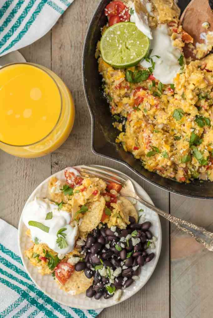 Skillet of eggs next to a plate of migas and black beans