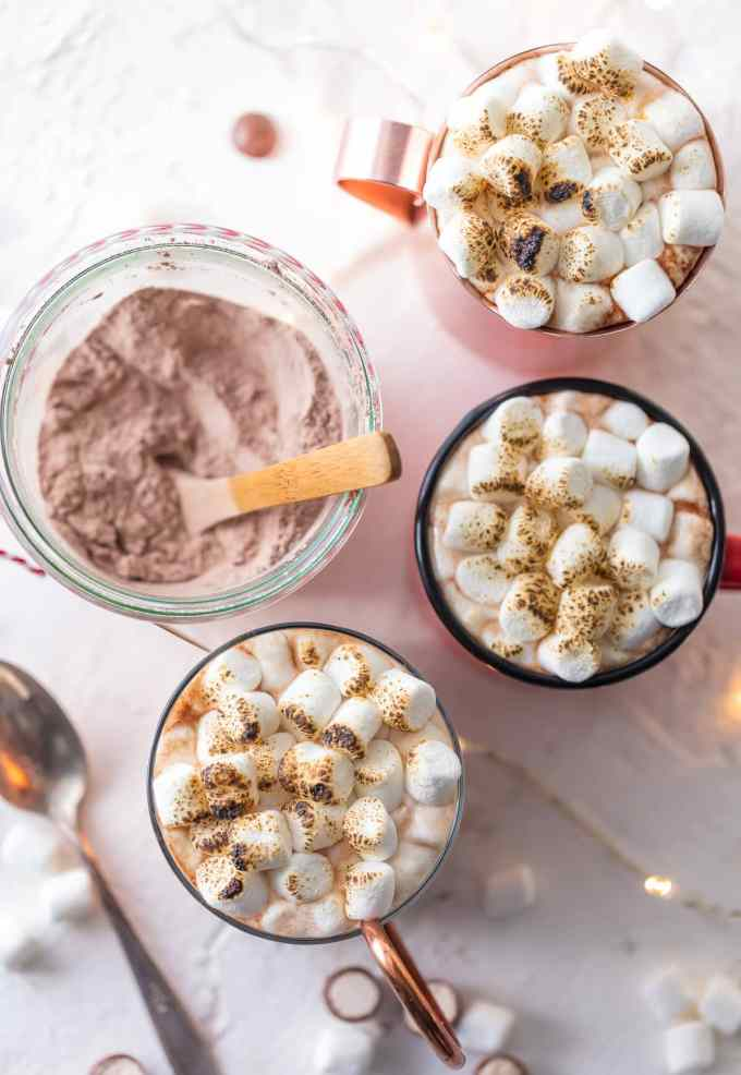 Malted Hot Chocolate topped with marshmallows in three mugs, views from above