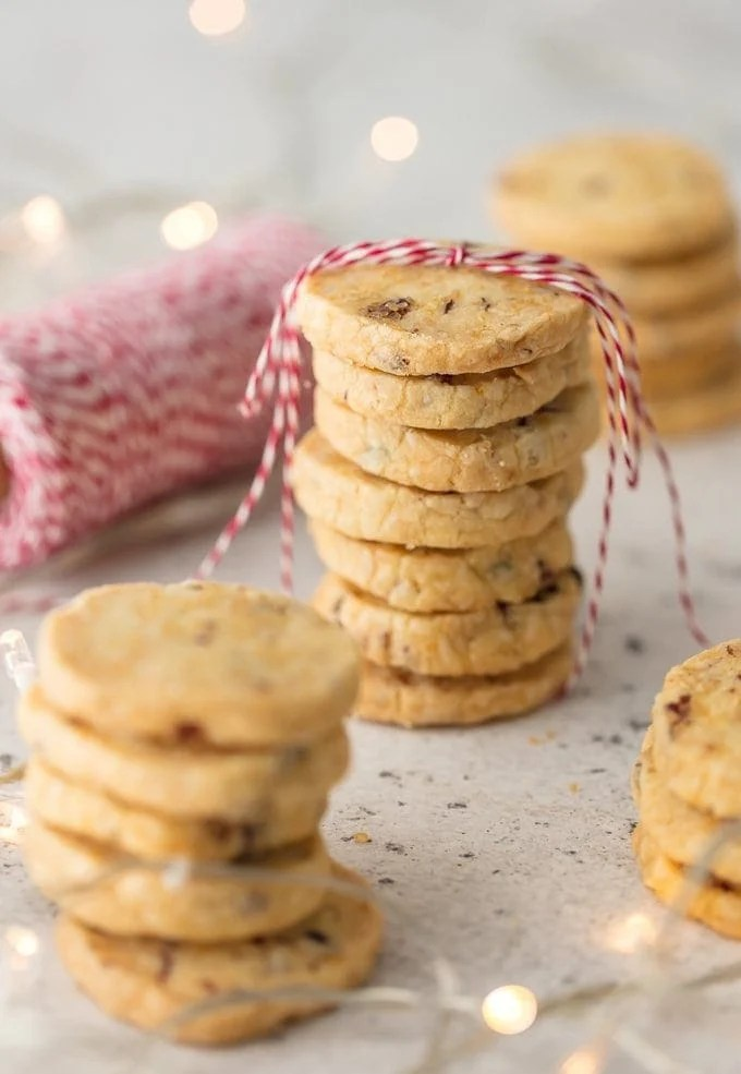 CRANBERRY ORANGE SHORTBREAD COOKIES have become an obsession at our house! It's one of our favorite Christmas cookie recipes and a must make for the holiday season. You're going to love these sweet Cranberry Shortbread Cookies!
