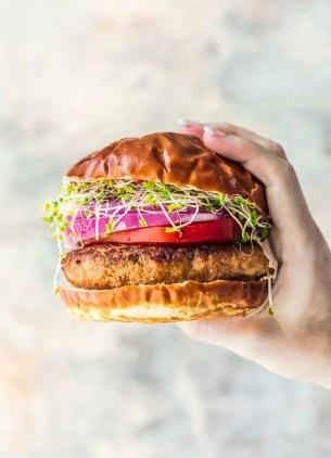 Hand holding a ground turkey burger
