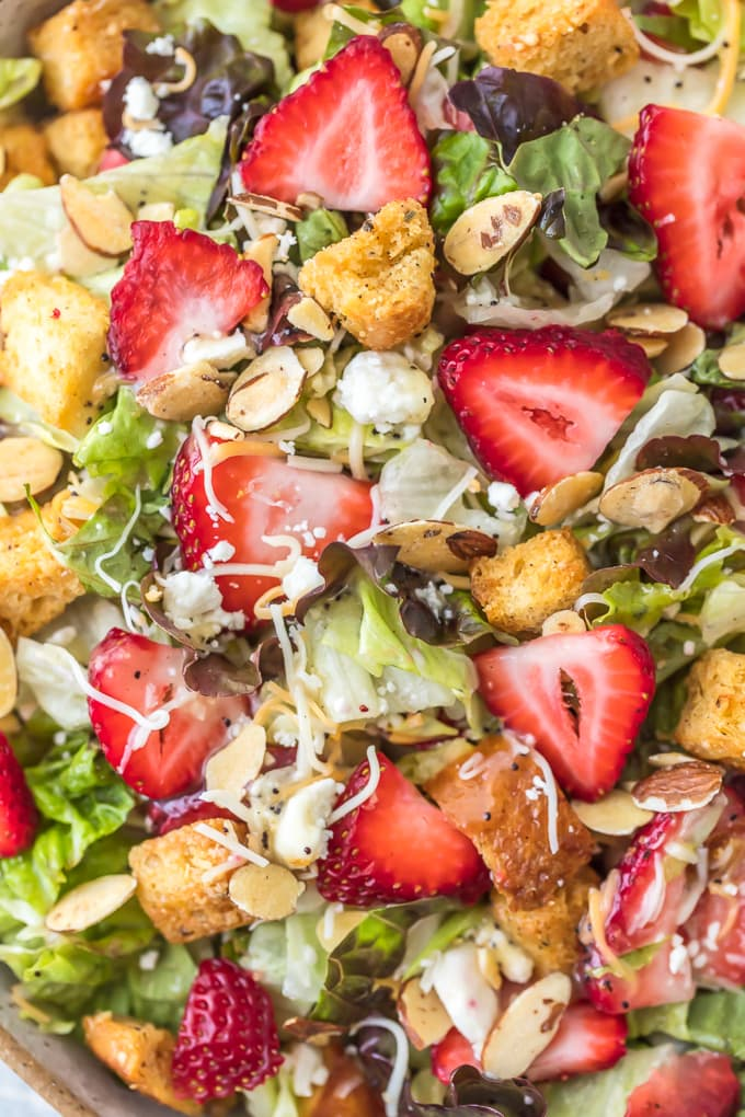 Fresh strawberry poppyseed salad dressed with homemade poppyseed dressing