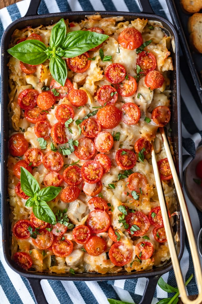 Chicken Alfredo Casserole topped with tomatoes and basil