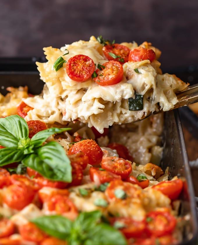 A spoonful of chicken alfredo casserole