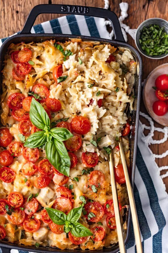 Chicken Alfredo Pasta Bake topped with cherry tomatoes and basil