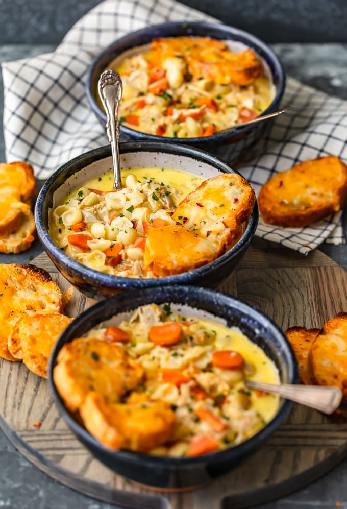 Chicken mac and cheese soup topped with cheesy toasted crostini