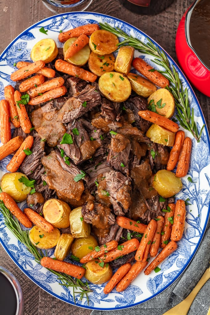 a plate of pot roast and veggies
