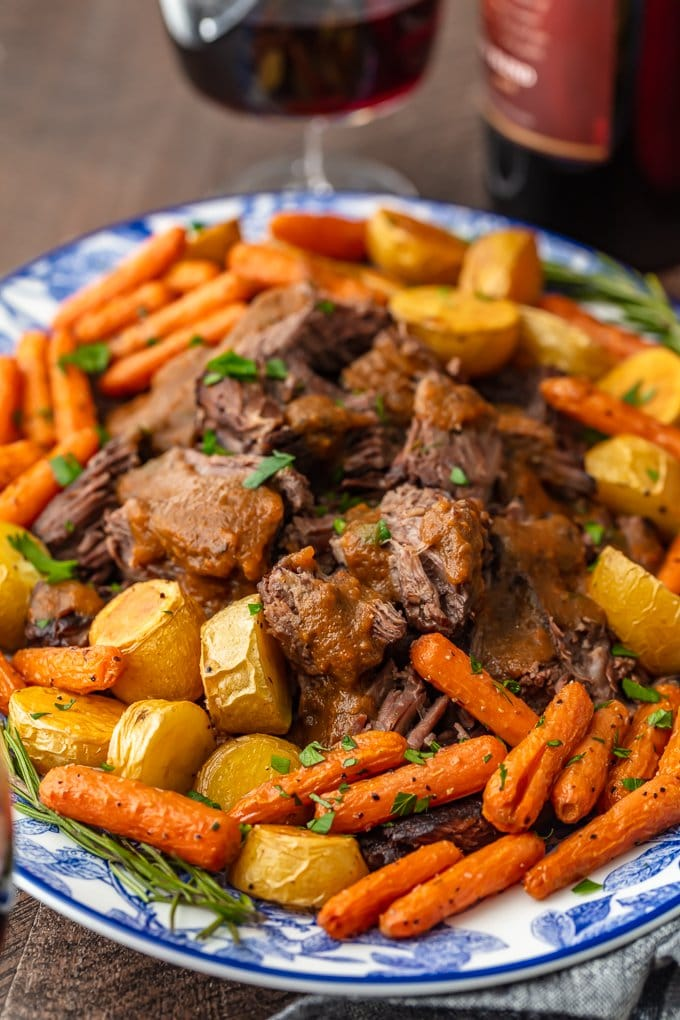 a serving platter filled with pot roast and veggies