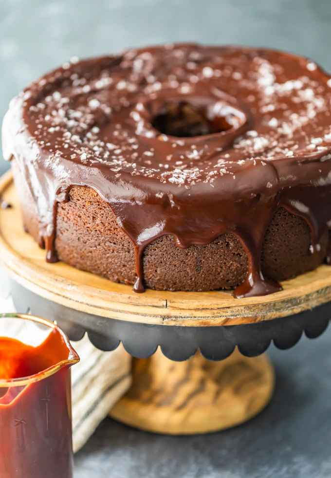 chocolate cake topped with chocolate icing and sea salt