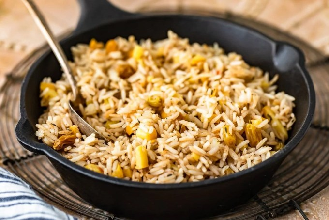 rice with apples and raisins in a skillet